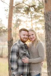 Man in plaid shirt and woman in tan sweater during their engagement session